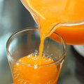 Fresh orange juice pouring from a jug Royalty Free Stock Photo