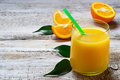 Fresh orange juice and sliced orange Royalty Free Stock Photo