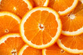 Fresh Orange juicy slices. Rich with vitamin C. background Royalty Free Stock Photo