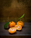 Fresh orange on an old chair still life Stock Photos