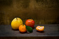 Fresh orange pear and apple on wood table an old still life Royalty Free Stock Photography