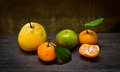 Fresh orange and pear on an old wood table still life Stock Image