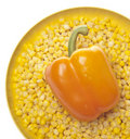 Fresh Orange Pepper in a Bowl of Frozen Corn Stock Photo
