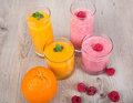 Fresh orange and raspberry smoothie drinks Stock Photography