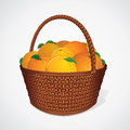 Fresh Oranges with Leaves in Wicker Basket Royalty Free Stock Photo