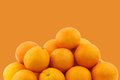 Fresh oranges on a orange background Royalty Free Stock Photos
