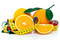 Fresh oranges and tape measure Royalty Free Stock Photo