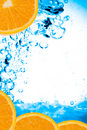 Fresh oranges and water Royalty Free Stock Photo