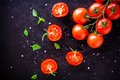Fresh organic cherry tomatoes with basil and sea salt Royalty Free Stock Photo