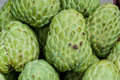 Fresh organic custard apples for sale at a market Stock Images
