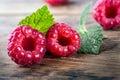 Fresh organic fruit raspberry on wood background Royalty Free Stock Photo