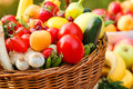 Fresh organic fruit and vegetables in a wicker basket Stock Photos