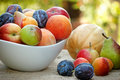 Fresh organic fruits in a bowl on the table Royalty Free Stock Images