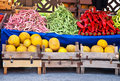 Fresh organic fruits and vegetables at a street market juan canary melon red green pepper red mullet kidney green beans Royalty Free Stock Images