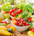 Fresh organic fruits and vegetables on a table Royalty Free Stock Photos