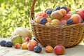 Fresh organic fruits in wicker basket on a table Royalty Free Stock Image