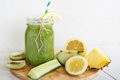 Fresh organic green smoothie with salad apple cucumber pineap pineapple and lemon as healthy drink Stock Photography