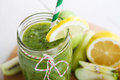 Fresh organic green smoothie with salad apple cucumber pineap pineapple and lemon as healthy drink Stock Photos