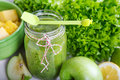 Fresh organic green smoothie with salad apple cucumber pineap pineapple and lemon as healthy drink Stock Images