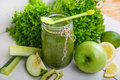 Fresh organic green smoothie with salad apple cucumber pineap pineapple and lemon as healthy drink Stock Image