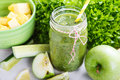 Fresh organic green smoothie with salad apple cucumber pineap pineapple and lemon as healthy drink Royalty Free Stock Image