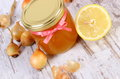 Fresh organic honey in glass jar onions and lemon healthy nutrition and strengthening immunity on old wooden background treatment Royalty Free Stock Photos