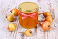 Fresh organic honey in glass jar and onions on wooden background healthy nutrition and strengthening immunity old rustic treatment Stock Image