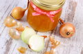 Fresh organic honey in glass jar and onions on wooden background healthy nutrition and strengthening immunity old rustic treatment Royalty Free Stock Photography