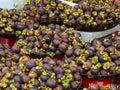 Fresh organic mangosteen fruits at the market Royalty Free Stock Photo