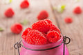 Fresh organic raspberries sweet on wooden background Royalty Free Stock Images