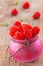 Fresh organic raspberries on wooden background Royalty Free Stock Photos