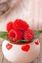 Fresh organic raspberries on wooden background Stock Images