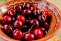 Fresh organic sweet cherries on ceramic bowl Healthy food concept. Summer fruits. Red fresh cherry