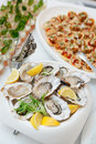 Fresh oysters and another dishes on restaurant table Royalty Free Stock Image