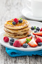 Fresh pancakes with honey and fruits Royalty Free Stock Photo