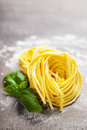 Fresh pasta and basil on wooden table Royalty Free Stock Photography