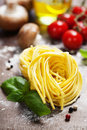 Fresh pasta and italian ingredients on wooden board Royalty Free Stock Photos