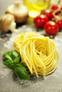 Fresh pasta and italian ingredients on wooden board Royalty Free Stock Images