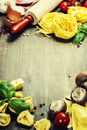 Fresh pasta and italian ingredients on wooden board Royalty Free Stock Photo
