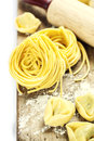 Fresh pasta making homemade on wooden table Royalty Free Stock Images
