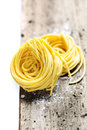 Fresh pasta on wooden table Stock Images