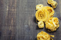 Fresh pasta on wooden table Stock Image