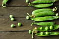 Fresh pea pods on a wooden table close up Stock Image