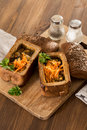 Fresh pea soup in bread bowl on a wooden desck Royalty Free Stock Photo