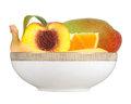Fresh peach; banana, orange and mango fruits in plate isolated o Royalty Free Stock Photo