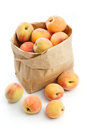 Fresh peaches in paper bag isolated Royalty Free Stock Photo
