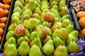 Fresh pears being sold in fruit market Royalty Free Stock Photo