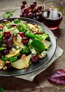 Fresh Pears, Blue Cheese salad with vegetable green mix, Walnuts, red grapes. healthy food Royalty Free Stock Photo