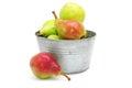Fresh pears in metallic bowl on white backgro Stock Image
