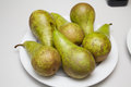 Fresh pears on a white plate Stock Photos